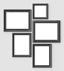 Black wood picture or photo frames on white wall with shadows with copy-space