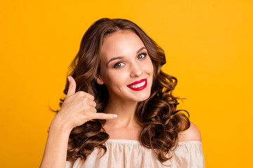 Close-up portrait of her she nice-looking attractive winsome lovely sweet pretty cheerful wavy-haired lady talking on invisible phone isolated over bright vivid shine yellow background