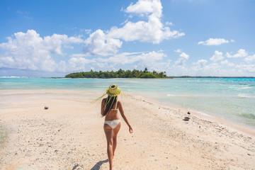 Wall Mural - Beach paradise bikini woman enjoying tropical getaway vacation in Rangiroa atoll, Tuamotu islands, French Polynesia.