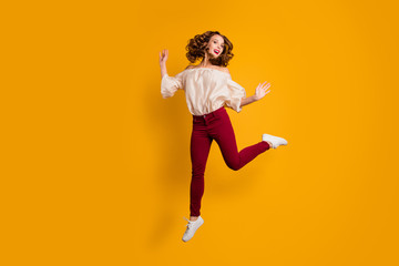 Wall Mural - Full length body size view portrait of her she nice-looking attractive lovely cheerful cheery wavy-haired lady having fun time isolated over bright vivid shine yellow background