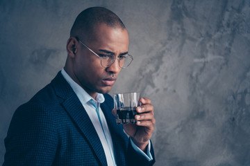Close up portrait sad worried gentleman boss sullen modern rich masculine luxury short hair bald trouble problem beverage thoughts stressed frustrated disappointed clothes isolated grey background