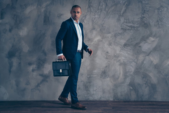 Full length body size view photo serious real estate agent moving hurrying have meeting appointment bald  focused corporate concept have bag look wear fashionable clothes isolated dark background