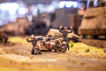 Conceptual photo showing a toy war among toy plastic soldiers with decorations