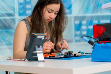 Schoolgirl in the classroom design and development of robots