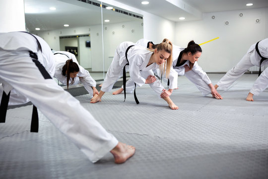 Martial art taekwondo combat fighters stretching and warming up