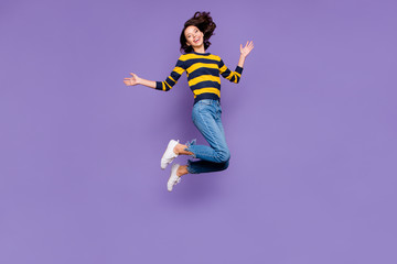 Wall Mural - Full length body size side profile photo beautiful amazing she her lady jump high flight party person people playful mood wear blue yellow striped pullover isolated violet purple background