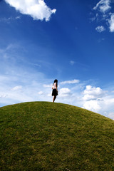 The girl who stands on a hill