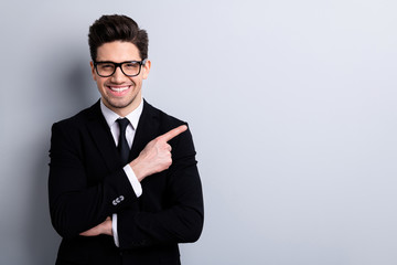 Portrait of his he nice imposing representative elegant classy chic attractive cheerful guy sales expert development agent broker pointing aside isolated over light gray background Wall mural