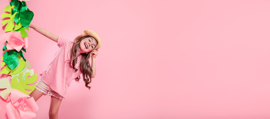 Little cute girl in summer hat on color background