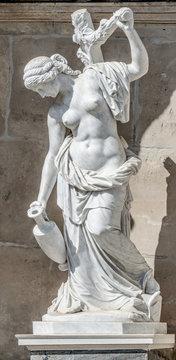 Ancient statue of a sensual renaissance era woman in Potsdam, Germany