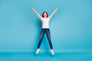 Wall Mural - Full length body size view portrait of her she nice attractive lovely cheerful cheery girlish girl wearing white tshirt having fun time isolated over bright vivid shine blue background