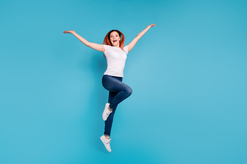 Wall Mural - Full length body size view portrait of her she nice attractive cheerful cheery girlish girl wearing white tshirt having fun celebrate day isolated over bright vivid shine blue background