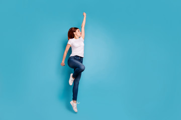 Wall Mural - Full length body size profile side view portrait of nice attractive cheerful strong girl in white tshirt active mood life lifestyle raising hand arm up isolated on bright vivid shine blue background