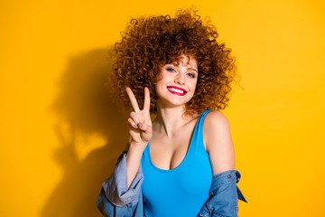 Close-up portrait of her she nice cute sweet charming winsome lovely attractive cheerful cheery optimistic wavy-haired girl showing v-sign isolated over bright vivid shine yellow background