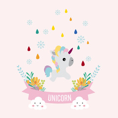 unicorn in rainbow and snow