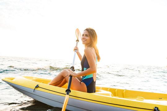 Attractive young woman kayaking
