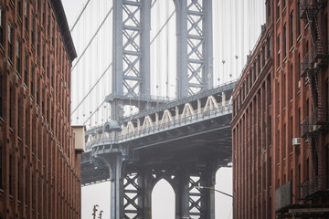 The famous view of the heart of the Manhattan bridge at Dumbo in the streets of Brooklyn - New York City, NY