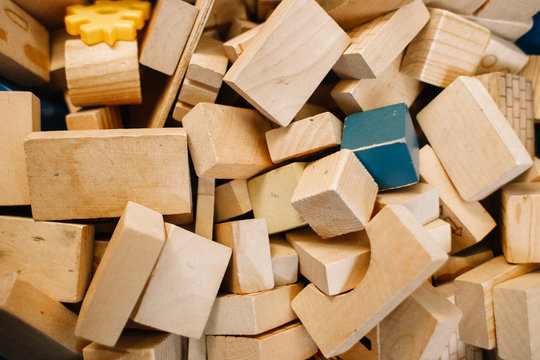 Toys in kindergarten. Chaotically scattered wooden blocks