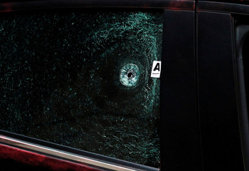 A gunshot damage to the window of a car that belongs to Mexican journalist Hector de Mauleon is seen at a crime scene in Mexico City