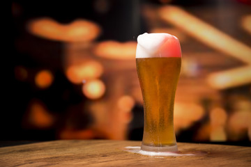Aluminium Prints Beer / Cider Beer glass in front of blurred background