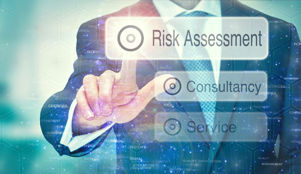 A business man selection a Risk Assessment button on a futuristic display with a concept written on it.