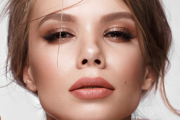 Pretty girl with easy hairstyle, classic makeup, nude lips Beauty face.