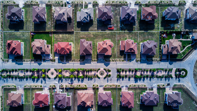 Top down aerial view of the houses, lined up in a pattern
