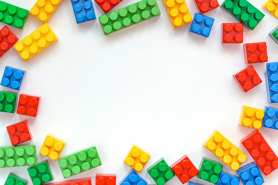 Educational toys for kids mockup, top view. Colorful plastic lego blocks on white background. copy space. concept of education, children's creativity