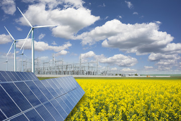 Green energy and transformer substation in a natural environment with blue sky and yellow rape field