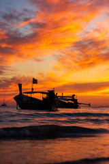 Wall Murals Shipwreck Traditional long-tail boat on the beach