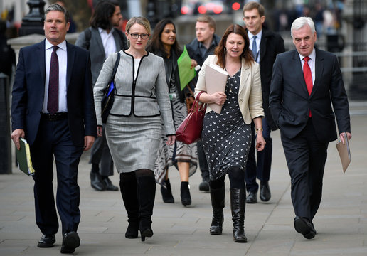 Britain's Shadow Chancellor of the Exchequer John McDonnell and Secretary of State for Departing the European Union Kier Starmer arrive at Cabinet Office in London