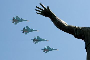 Su-34 military fighter jets fly in formation during a rehearsal for the Victory Day parade in Moscow