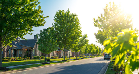 View of modern residential houses neighborhood street in Bentonville, Northwest Arkansas, sunny...