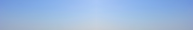 Blue sky background. Empty pale blue sky texture, elongated bluish banner