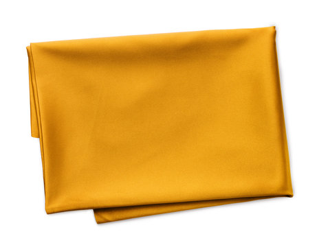 folded piece of yellow satin fabric isolated on white background