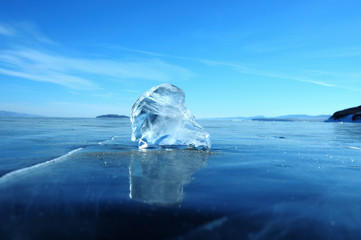the sun's rays are refracted in crystal clear pieces of ice. winter landscape. Lake Baikal