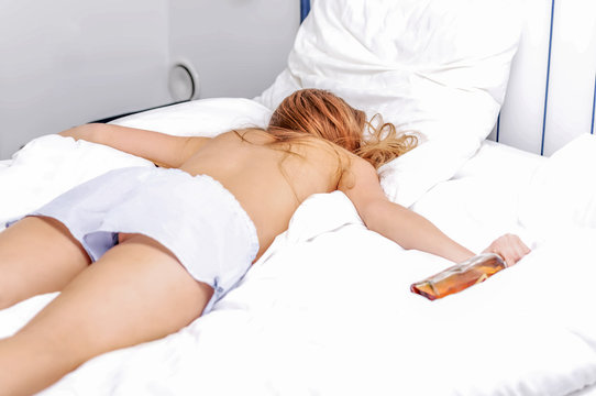 Drunk woman lying because of passed out after party. Alcohol addiction.