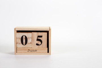 Wooden calendar June 05 on a white background