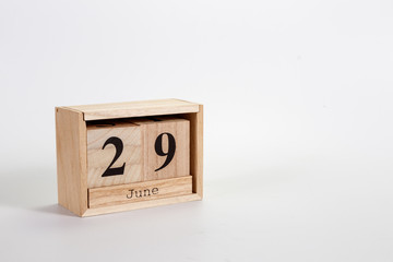 Wooden calendar June 29 on a white background