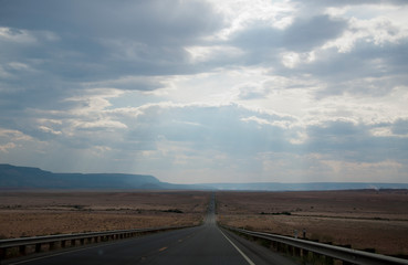 Foto op Canvas Donkergrijs Long straight highway in southwest USA