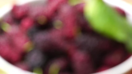 Fototapete - Focusing a pile of fresh mulberries in a white bowl