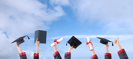 graduation ceremony  concept hat and diploma up raised hands