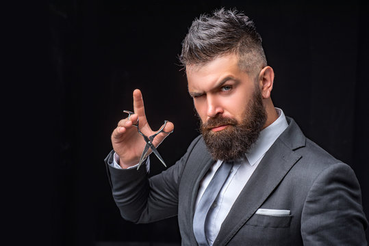 beard care. Mature hipster with beard. bearded man in formal business suit. brutal male hipster cut hair with hairdressing scissors. confident businessman at barbershop. barber and hairdresser salon