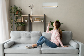 Happy woman holding cooler system remote controller enjoy fresh air
