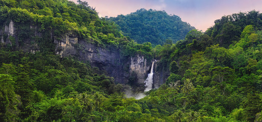 Recess Fitting Waterfalls Wonderful Landscape of Cascade Waterfall in Tropical Rainforest. Scenery of Rocky Cliff and Cimarinjung Waterfall at UNESCO Global Geopark Ciletuh.
