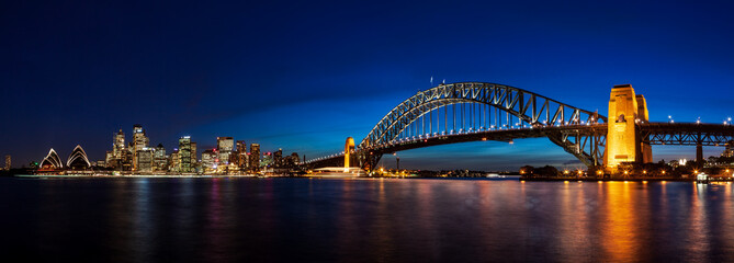 Wall Mural - Panorama of Sydney Downtown and the Harbor Bridge by Night Blue Hour