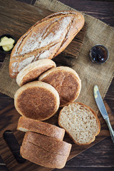 Fresh Bread On Wooden Table.
