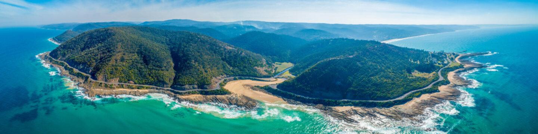 Famous Great Ocean Road passing through breathtaking coastline - aerial panoramic landscape