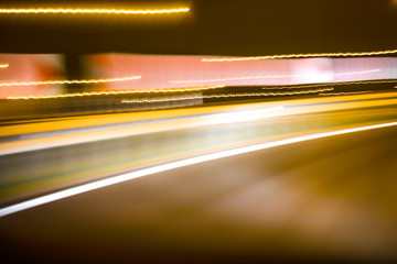 Fotomurales - City colorful night lights perspective blurred by high speed of the car. A streak of light, trails.