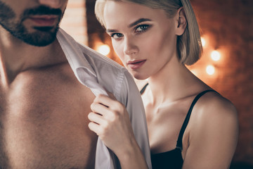 Cropped close up photo hot two people partners she her lady touch hands he him his handsome shoulders taking off white shirt wife husband anniversary morning full wish want eager house room indoors